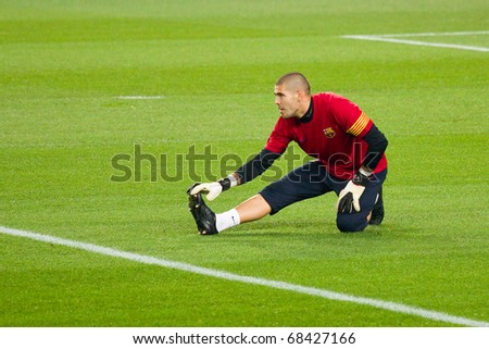 BARCELONA - DECEMBER 13: Nou Camp stadium, Spanish Soccer League match: FC Barcelona - Real Sociedad, 5 - 0. In the picture, Victor Valdes, the goalkeeper. December 13, 2010 in Barcelona (Spain). - stock photo