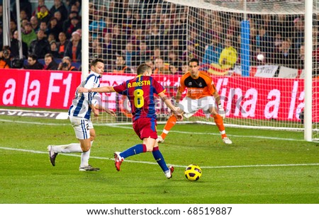 BARCELONA - DECEMBER 13: Nou Camp stadium, Spanish Soccer League match: FC Barcelona - Real Sociedad, 5 - 0. In the picture, Andres Iniesta shooting a goal. December 13, 2010 in Barcelona (Spain). - stock photo