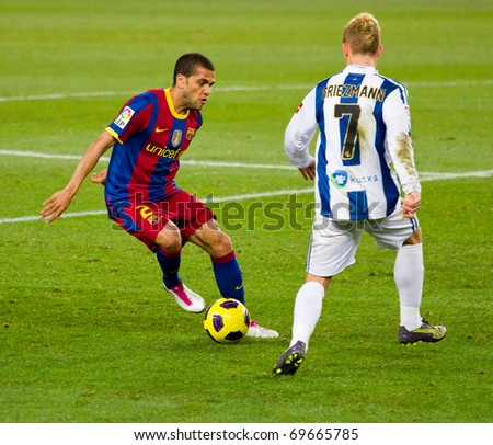 BARCELONA - DECEMBER 13: Nou Camp stadium, Spanish Soccer League match: FC Barcelona - Real Sociedad, 5 - 0. In the picture, Dani Alves and Griezmann in action. December 13, 2010 in Barcelona (Spain). - stock photo