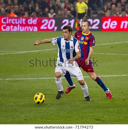 BARCELONA - DECEMBER 13: Nou Camp stadium, Spanish Soccer League match: FC Barcelona - Real Sociedad, 5 - 0. In the picture, Prieto (10) and Iniesta in action. December 13, 2010 in Barcelona (Spain). - stock photo