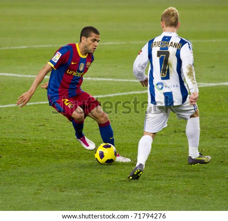 BARCELONA - DECEMBER 13: Nou Camp stadium, Spanish Soccer League match: FC Barcelona - Real Sociedad, 5 - 0. In the picture, Alves (2) and Griezmann (7). December 13, 2010 in Barcelona (Spain). - stock photo