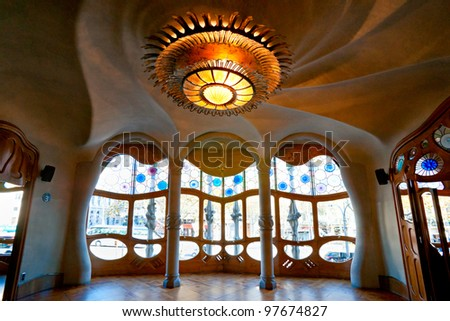 BARCELONA - DECEMBER 16: The house Casa Battlo (also could the house of bones) designed by Antoni Gaudi­ with his famous expressionistic style on December 16, 2011 Barcelona, Spain - stock photo
