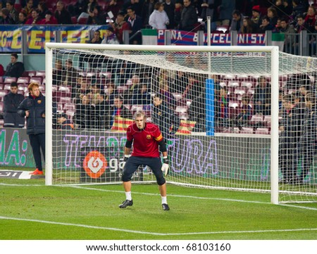 BARCELONA - DECEMBER 13: Victor Valdes in action on the soccer field at Nou Camp Stadium. The Spanish team FC Barcelona beat the Real Sociedad, 5-0, December 13, 2010 in Barcelona (Spain). - stock photo