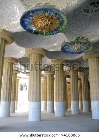 Barcelona: detail of ceramic mosaic ceilings at the Columns Hall in Park Guell, the famous and beautiful park designed by Antoni Gaudi, one of the highlights of the city - stock photo