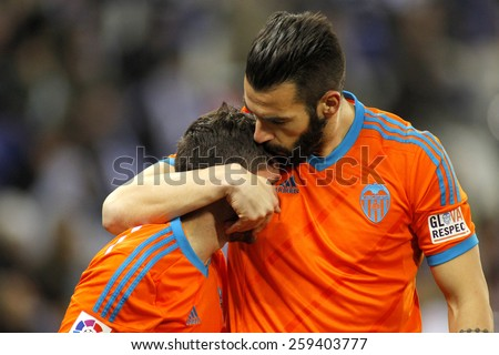 BARCELONA - 8, FEB: Alvaro Negredo embraces Pablo Piatti of Valencia CF during spanish League match against RCD Espanyol at the Estadi Cornella on February 8, 2015 in Barcelona, Spain - stock photo