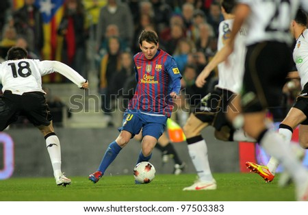 BARCELONA - FEB, 19: Leo Messi of FC Barcelona in action during the Spanish league match against Valencia CF at the Camp Nou stadium on February 19, 2012 in Barcelona, Spain - stock photo