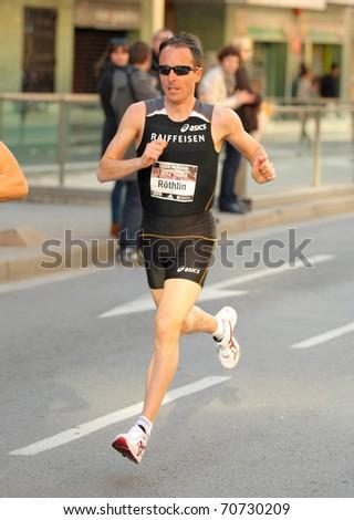 BARCELONA - FEB 6: The European champion Marathon in Barcelona 2010, Viktor Rothlin, running during Granollers Half Marathon at Granollers on February 6, 2011 in Barcelona, Spain. - stock photo
