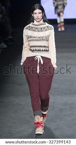BARCELONA - FEBRUARY 05: a model walks on the Aldomartins catwalk during the 080 Barcelona Fashion runway Fall/Winter 2015 on February 05, 2015 in Barcelona, Spain.  - stock photo