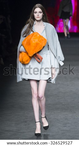 BARCELONA - FEBRUARY 04: a model walks on the Menchen Tomas catwalk during the 080 Barcelona Fashion runway Fall/Winter 2015 on February 04, 2015 in Barcelona, Spain.  - stock photo