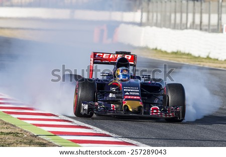 BARCELONA - FEBRUARY 28: Carlos Sainz of Toro Rosso at third day of Formula One Test Days at Catalunya Circuit on February 28, 2015 in Barcelona, Spain. - stock photo