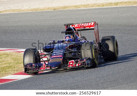 BARCELONA - FEBRUARY 22: Carlos Sainz racing with his Toro Rosso at Formula One Test Days at Catalunya circuit, on February 22, 2015, in Barcelona, Spain. - stock photo