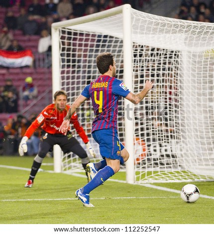 BARCELONA - FEBRUARY 2: Cesc Fabregas (4) in action during the Spanish Cup match between FC Barcelona and Valencia CF, final score 2-0, on February 2, 2012, in Camp Nou stadium, Barcelona, Spain. - stock photo