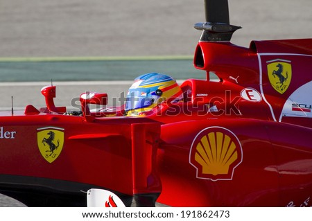 BARCELONA - FEBRUARY 21: Fernando Alonso of Ferrari F1 team racing at Formula One Teams Test Days at Catalunya circuit on February 21, 2012 in Barcelona, Spain. - stock photo