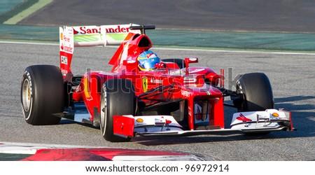 BARCELONA - FEBRUARY 21: Fernando Alonso of Ferrari F1 team racing during Formula One Teams Test Days at Catalunya circuit on February 21, 2012 in Barcelona, Spain. - stock photo