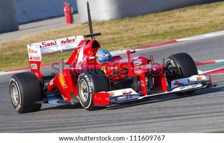 BARCELONA - FEBRUARY 21: Fernando Alonso of Ferrari team racing at Formula One Teams Test Days at Catalunya circuit on February 21, 2012 in Barcelona, Spain. - stock photo