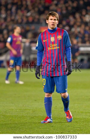 BARCELONA - FEBRUARY 2: Leo Messi in action during the Spanish Cup match between FC Barcelona and Valencia CF, final score 2-0, on February 2, 2012, in Camp Nou stadium, Barcelona, Spain. - stock photo