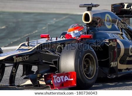 BARCELONA - FEBRUARY 21: Romain Grosjean of Lotus Renault F1 team racing at Formula One Teams Test Days at Catalunya circuit on February 21, 2012 in Barcelona, Spain. - stock photo