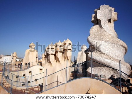BARCELONA - FEBRUARY 18:The architect  Gaudi treated rooftop elements  like chimneys  as striking sculptures on the rooftop of the house Casa Mila /La Pedrera on February 18, 2011 in Barcelona, Spain - stock photo