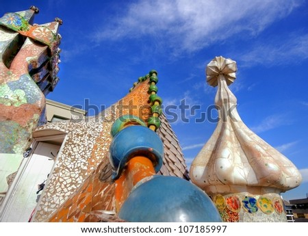BARCELONA - FEBRUARY 18: The famous architect Gaudi�­ treated rooftop chimneys like pieces of art on the rooftop of the house Casa Batllo on February 18, 2011 in Barcelona, Spain. - stock photo
