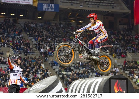 BARCELONA - FEBRUARY 9: Toni Bou, the world champion, compete at Trial Indoor of Barcelona, on February 9, 2014, in Palau Sant Jordi stadium, Barcelona, Spain. He was the winner. - stock photo