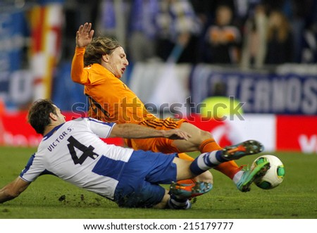 BARCELONA - JAN, 21: Luka Modric of Real Madrid during the Spanish Kings Cup match between Espanyol and Real Madrid at the Estadi Cornella on January 21, 2014 in Barcelona, Spain - stock photo