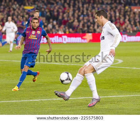 BARCELONA - JANUARY 25: Cristiano Ronaldo (R) in action at the Spanish Cup match between FC Barcelona and Real Madrid, final score 2 - 2, on January 25, 2012, in Camp Nou, Barcelona, Spain. - stock photo