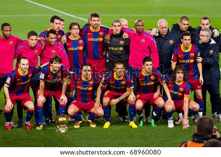 BARCELONA - JANUARY 12: Football Club Barcelona players with the FIFA World Player Trophy of Leo Messi. January 12, 2011 in Nou Camp soccer stadium, Barcelona (Spain). - stock photo