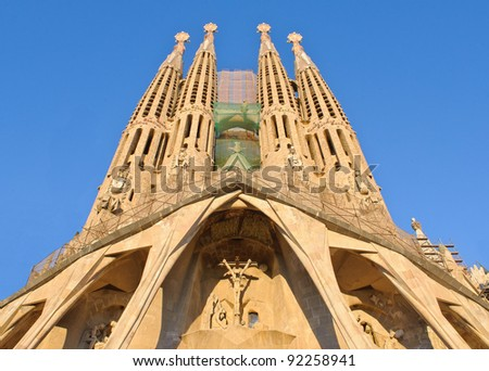 BARCELONA – JANUARY 8: La Sagrada Familia, cathedral designed by Antoni Gaudi that is being build since 1882, on January 8, 2012, Barcelona, Spain. - stock photo