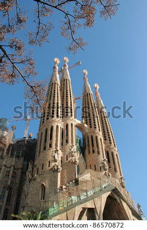 BARCELONA - JANUARY 16: La Sagrada Familia - the amazing cathedral designed by Gaudi, in construction since 1882, after Pope Benedict XVI consecration in 2010. January 16, 2011 in Barcelona, Spain. - stock photo