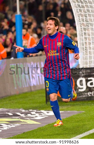 BARCELONA - JANUARY 4: Leo Messi celebrating a goal during the Spanish Cup match between FC Barcelona and Osasuna, final score 4 - 0, on January 4, 2012 in Camp Nou stadium, Barcelona, Spain. - stock photo
