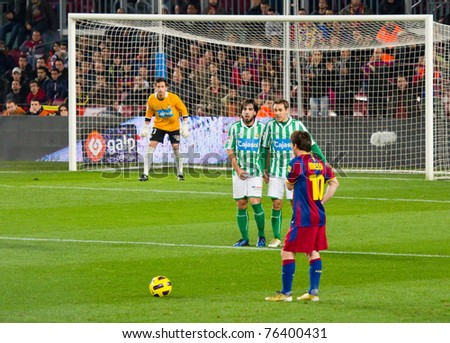 BARCELONA - JANUARY 12: Leo Messi (10) shooting a free kick during the football Spanish Cup between FC Barcelona and Real Betis, final score 5 - 0, on January 12, 2011 in Barcelona, Spain. - stock photo