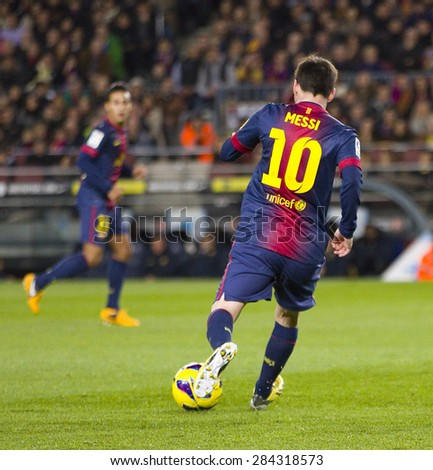 BARCELONA - JANUARY 4: Lionel Messi (10) of FCB in action at the Spanish League match between FC Barcelona and Osasuna, final score 5 - 1, on January 27, 2013, in Barcelona, Spain. - stock photo