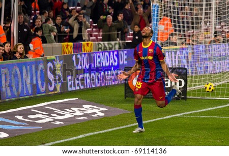 BARCELONA - JANUARY 12: Nou Camp football stadium, soccer Spanish Cup: FC Barcelona - Real Betis, 5 - 0. In the picture, Seydou Keita celebrating a goal. January 12, 2011 in Barcelona (Spain). - stock photo