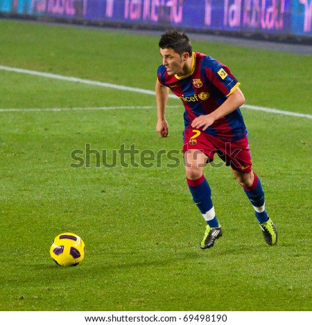 BARCELONA - JANUARY 16: Nou Camp football stadium, soccer Spanish League match: FC Barcelona - Malaga, 4 - 1. In the picture, David Villa in action. January 16, 2011 in Barcelona (Spain). - stock photo