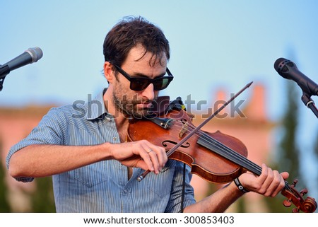 BARCELONA - JUL 4: Andrew Bird (musician, songwriter, and multi-instrumentalist) performs at Vida Festival on July 4, 2015 in Barcelona, Spain. - stock photo