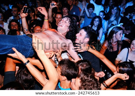 BARCELONA - JULY 23: Adam Green performs and jumps over the public several times at Discotheque Razzmatazz on July 23, 2010 in Barcelona, Spain. - stock photo