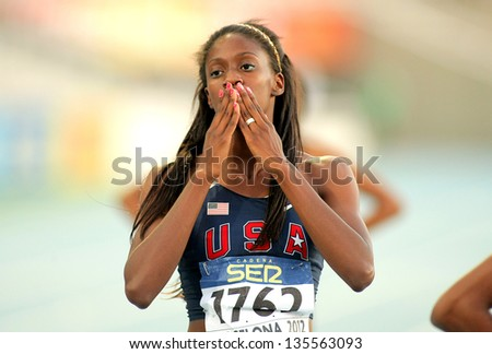 BARCELONA - JULY, 13: Ashley Spencer of USA celebrating gold in relays event of the 20th World Junior Athletics Championships at the Olympic Stadium on July 13, 2012 in Barcelona, Spain - stock photo