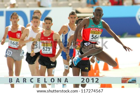 BARCELONA - JULY, 13: Competitors of 3000m steeplechase event during the 20th World Junior Athletics Championships at the Olympic Stadium on July 13, 2012 in Barcelona, Spain - stock photo