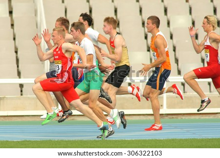 BARCELONA - JULY, 10: Competitors on start of 100m of Decathlon  men during the 20th World Junior Athletics Championships at the Olympic Stadium on July 10, 2012 in Barcelona, Spain - stock photo