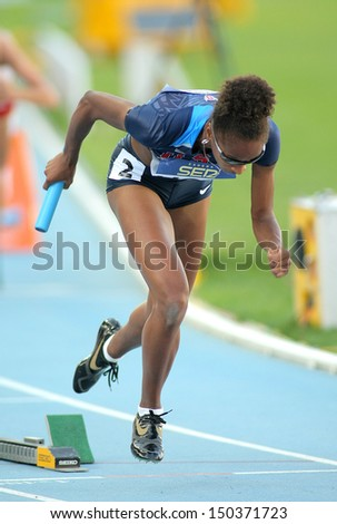 BARCELONA - JULY, 14: Kendall Baisden of USA competes on 4X400 Relay of the 20th World Junior Athletics Championships at the Olympic Stadium on July 14, 2012 in Barcelona, Spain - stock photo