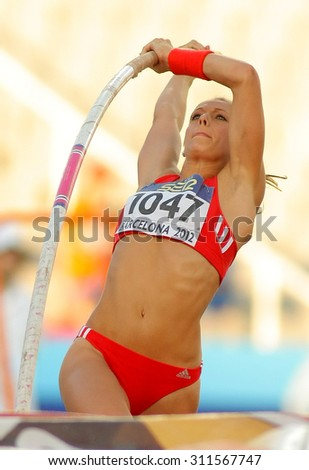BARCELONA - JULY, 14: Kira Grunberg of Austria in action during Pole Vault Event of the 20th World Junior Athletics Championships at the Olympic Stadium on July 14, 2012 in Barcelona, Spain - stock photo
