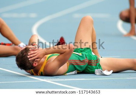 BARCELONA - JULY, 13:Marius Savelskis of Lithuania during 10000 metres race walk event of of the 20th World Junior Athletics Championships at the Olympic Stadium on July 13, 2012 in Barcelona, Spain - stock photo