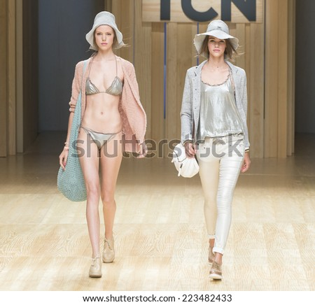 BARCELONA - JULY 01: models walking on the TCN catwalk during the 080 Barcelona Fashion runway Spring/Summer 2015 on July 01, 2014 in Barcelona, Spain.  - stock photo