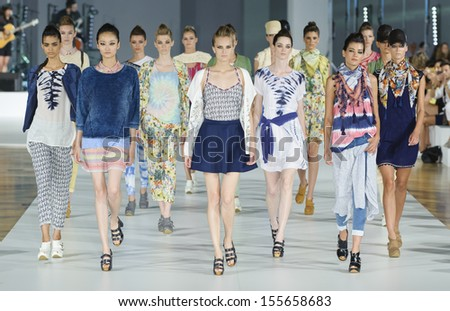 BARCELONA - JULY 11: Models walking on the Yerse catwalk during the 080 Barcelona Fashion runway on July 11, 2013 in Barcelona, Spain.  - stock photo