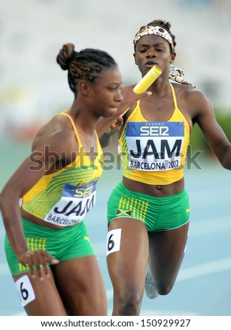 BARCELONA - JULY, 14: O. James(L) and S. Farquharson(R) of Jamaica  competes on 4X400 Relay of the 20th World Junior Athletics Championships at the Olympic Stadium on July 14, 2012 in Barcelona, Spain - stock photo