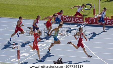 BARCELONA - JULY 28: Some unidentified athletes compete at Decathlon 100 meters during European Athletics Championships Barcelona 2010 on July 28, 2010 in Olympic stadium, Barcelona, Spain. - stock photo