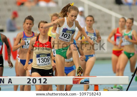 BARCELONA - JULY, 10: Tessa Potezny of Australia during 3000m steeplechase event of the 20th World Junior Athletics Championships at the Olympic Stadium on July 10, 2012 in Barcelona, Spain - stock photo