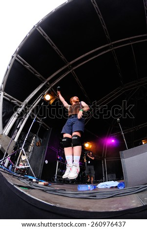 BARCELONA - JUN 13: A former of FM Belfast (electro pop band) jumps during a song at Sonar Festival on June 13, 2014 in Barcelona, Spain. - stock photo
