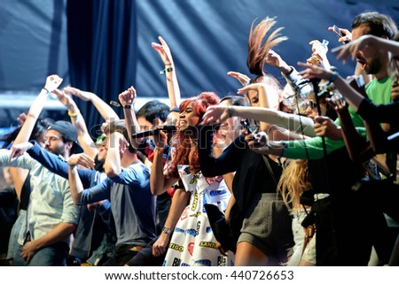 BARCELONA - JUN 18: Santigold (band) perform in concert surrounded by fans at Sonar Festival on June 18, 2016 in Barcelona, Spain. - stock photo
