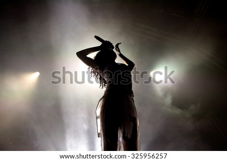 BARCELONA - JUN 20: Silhouette of the singer of FKA Twigs (band), in concert at Sonar Festival on June 20, 2015 in Barcelona, Spain. - stock photo